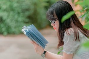 Young girl reading spiritual book